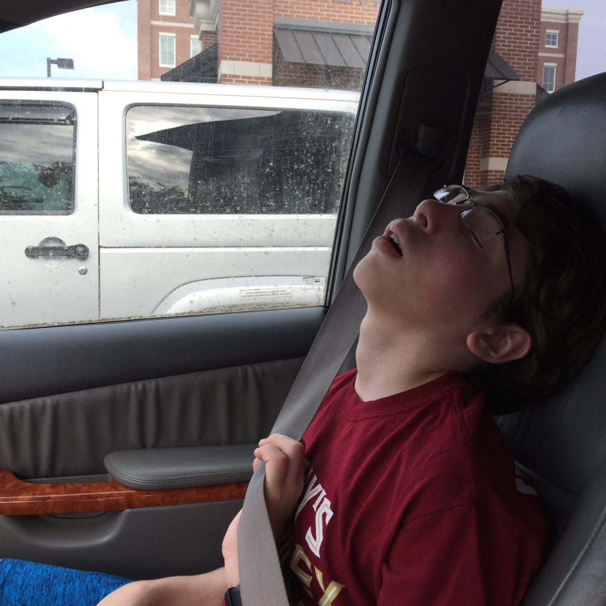 Avner asleep in the car